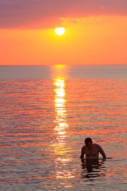Swimming at sunset