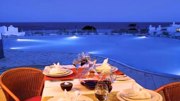 Dining by the pool at the Villas d'Agua resort in Portugal