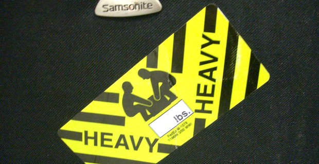 Heavy tag on overweight luggage